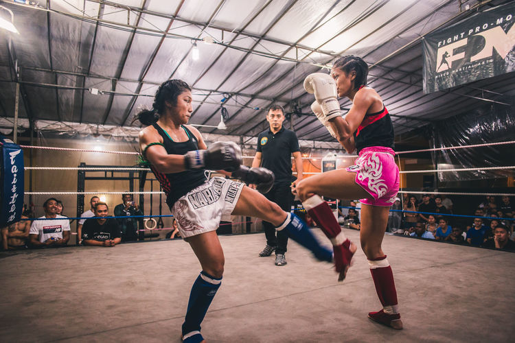 Never Back Down. International Women's Day 2019 Women Sport Real People Boxing - Sport Motion Vitality Sports Clothing Strength Young Women Healthy Lifestyle Exercising Punching Effort People Muay Thai Sportswoman Kicking Kickboxing Analogue Sound