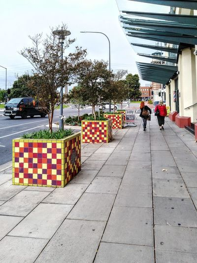 Planterboxes Squares, And More Squares Cube Squares, Squares, & More Squares Sidewalk Planter Boxes People In The Distance Two People In The Distance People In The Background Two People In The Background Two Women People Walking  Adelaide S.A. City Of Adelaide Taking Photos Taking Pictures Two 2 People In The Distance 2people Two People 2 People Twopeople Streetphotography Street Photography Streetphoto_color Adelaide, South Australia Street Adelaide Street Scene City Street