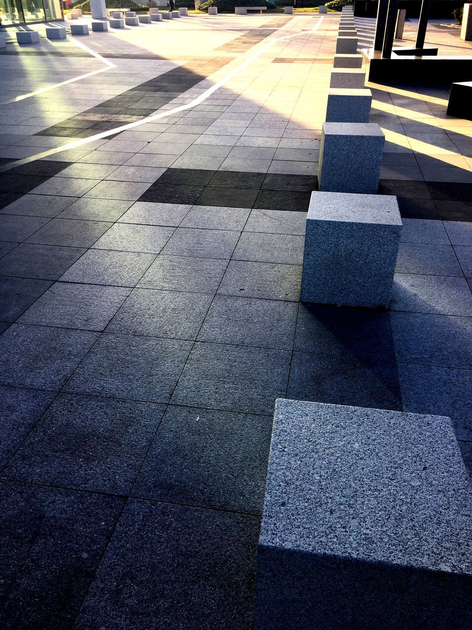 sunlight, transportation, flooring, day, no people, pattern, shadow, tile, footpath, city, architecture, outdoors, sign, road marking, tiled floor, nature, direction, street, symbol, high angle view, paving stone, surface level