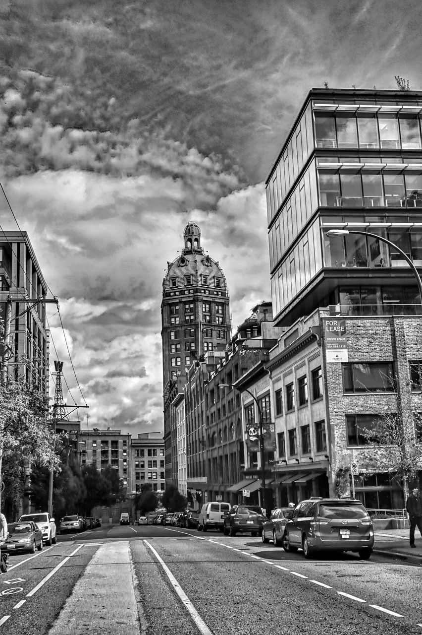 building exterior, architecture, built structure, city, cloud - sky, sky, outdoors, street, day, road, car, residential building, land vehicle, no people, cityscape