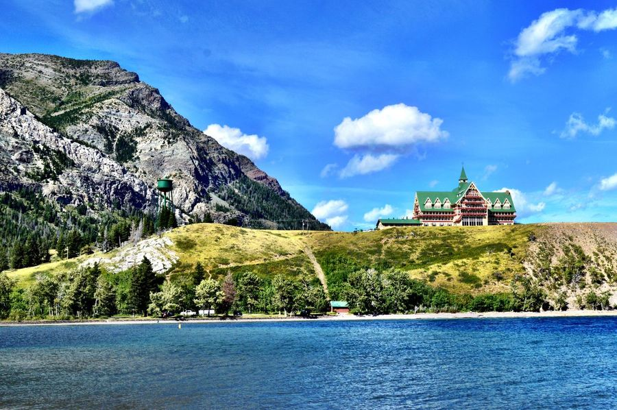 Built in 1927, the historic Prince of Wales Hotel has withstood the test of time and weather. The iconic hotel is on the top of a hill overlooking the village of Waterton which offers the best view of Waterton Lakes and the southern part of the Canadian Rockies. EyeEmNewHere EyeEm Ready   Waterton Lakes National Park Architecture Cloud - Sky Beauty In Nature Scenics Nature Water Sky