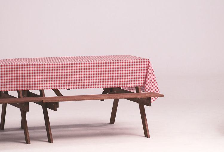 Wood table and red napkin for outdoor party and white background. Day Napkin No People Object Party Red Studio Table Table; Napkin; Tablecloth; Wood; Background; White; Checkered; Red; Wooden; Empty; Traditional; Textile; Surface; Texture; Rustic; Backdrop; Restaurant; Cover; Fabric; Cloth; Pattern; Design; Outdoor; Studio; Isolated; Vintage; Clean; Country; Cotton; Pic Wood - Material