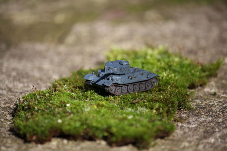 Close-Up Of Toy Armored Tank On Grass