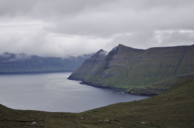 faroe island view. Awe Cliffs Cloud - Sky Clouds Coast Coastline Day Faroe Islands Fjord Landscape Mountain Mountain Peaks Mountain Range Mountain View Nature No People Ocean Outdoors Peak Sea Shore Shoreditch Shoreline Shorelines Water