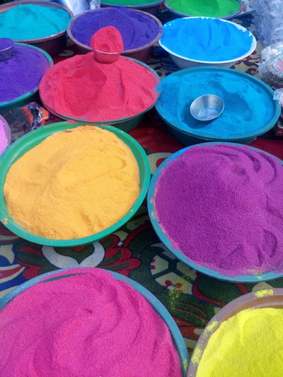 Art And Craft, Blue Choice Circle Cultures Day Diwali For Sale Holi Indian Culture, Market Merchandise Multi Colored No People Outdoors Powder Paint Religion Retail  Vertical