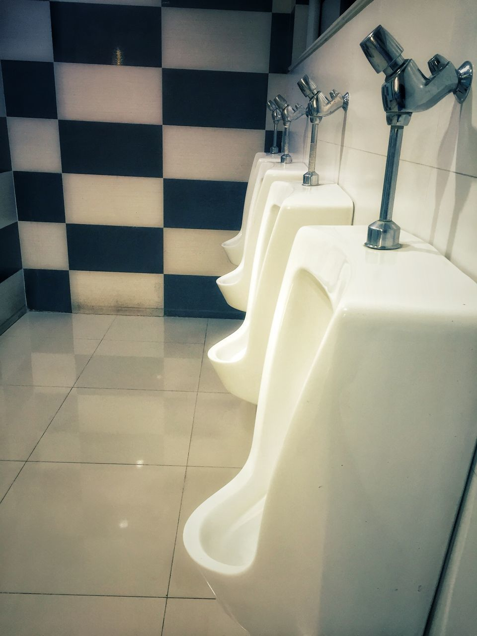 bathroom, flooring, tile, indoors, hygiene, toilet, white color, urinal, no people, tiled floor, domestic room, domestic bathroom, home, home interior, absence, convenience, white, household equipment, close-up, clean