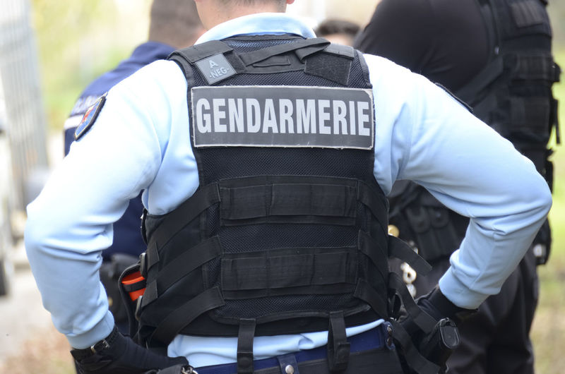 gendarme, intervention uniform of a french policeman French Police Gendarme Gendarmerie Nationale Authority Clothing Government Law Men Occupation Outdoors People Police Force Protection Real People Rear View Responsibility Safety Security Standing Text Uniform