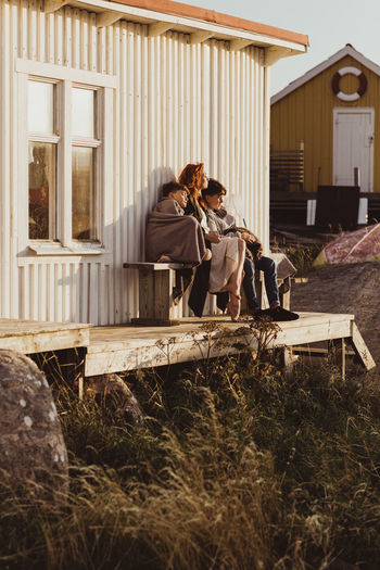 People sitting in front of built structure