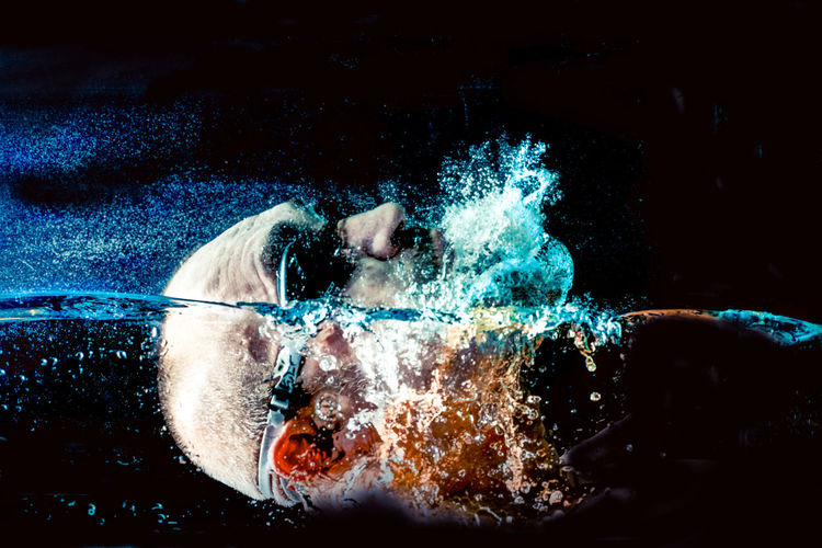 Close-up of man swimming in water
