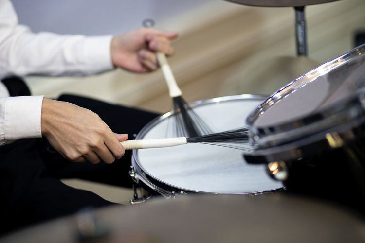 Hands of a man playing a drum set Drum - Percussion Instrument One Person Music Drummer Drumstick Percussion Instrument Human Hand Hand Real People Musical Instrument Musical Equipment Musician Arts Culture And Entertainment Indoors  Playing Holding Human Body Part Drum Kit Drum Lifestyles Preparation  Skill  Hitting