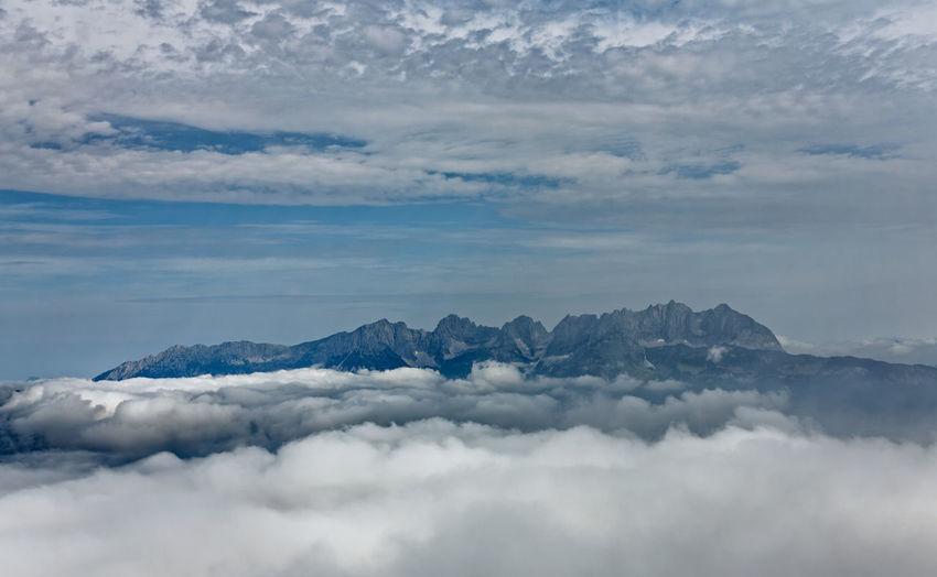 Mountain landscape of Austria, Kitzbühel. Landscape Austria Austrian Alps Cloud Kitzbühel Morning Mountain Landscape Of Austria. Nature Travel Clouds And Sky Fog Forest Kitzbuhel Alpen Kitzbüheler Alpen Sky