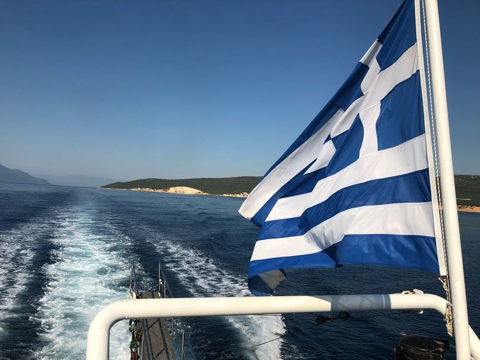 Waves after waves. 🌊 Photoshop Island Greece Waves Mountain Vacations Holiday Sea Summer Photography IPhoneography Ferry Water Sky Blue Nature No People Patriotism Flag Sea Clear Sky Day Wake - Water Outdoors Striped Motion