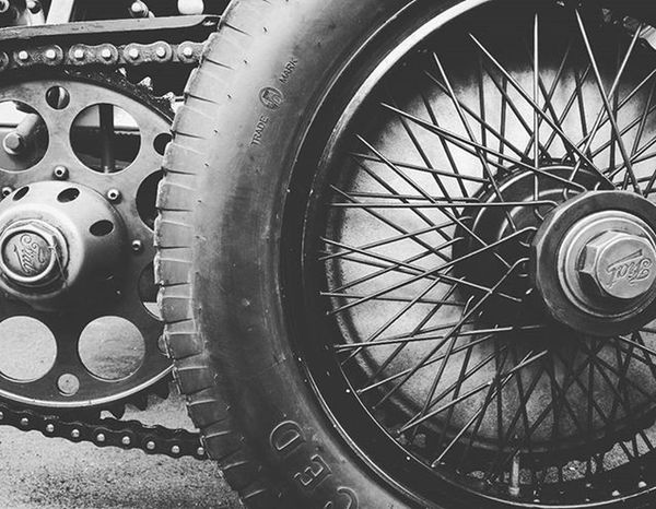 The devil is in the detail. @goodwoodrrc have organised another wonderful event. 74mm Racing Motorracing Style Membersmeeting Blackandwhite Blackandwhitephotography Wirewheels Chaindrive Fiat