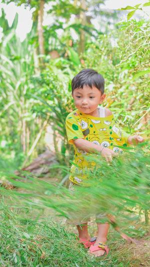 Portrait of boy smiling on field