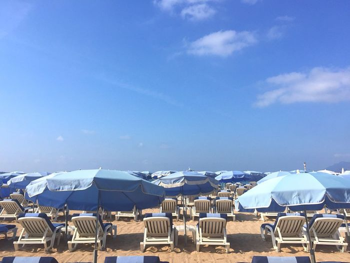 Lounge chairs and umbrellas on beach