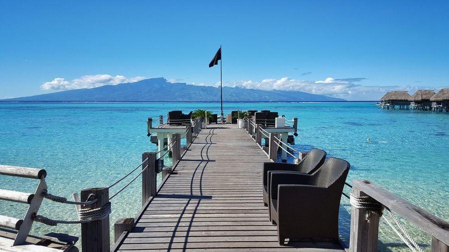 Seats on pier over sea at hotel sofitel moorea ia ora beach resort
