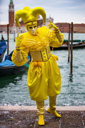 Carnival Carnival In Venice Venice, Italy Carnival Masks Costume Day Full Length Lifestyles Mask - Disguise One Person Outdoors Real People Standing Venetian Mask Water Yellow Young Adult
