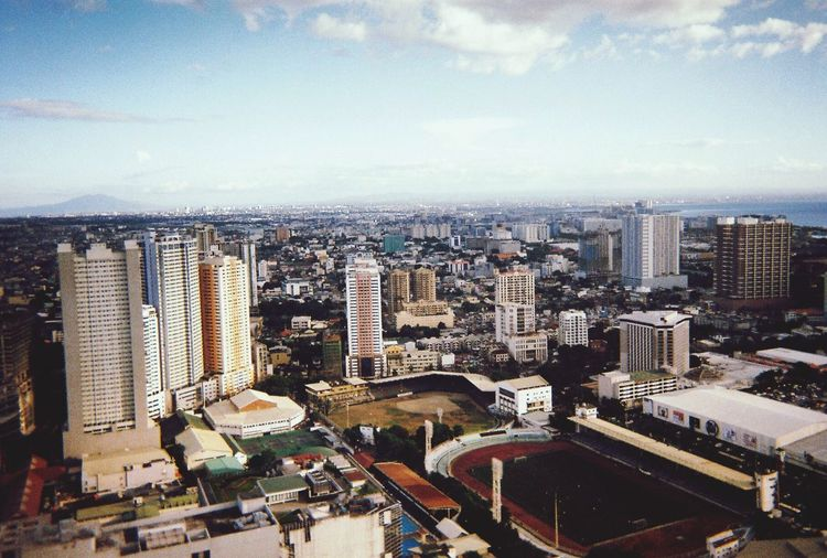 Manila — Forward ever, backwards never Eyeem Philippines Urban Landscape Urban Skyline Urban Disposable Camera Photography Disposable Camera Disposablecamera Fujifilm EyeEmNewHere Manila, Philippines Manila Cityscape City Building High Angle View Cloud - Sky Skyscraper Office Building Exterior Day First Eyeem Photo