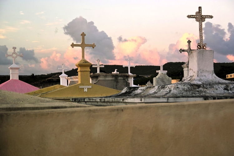 Sunset over the old cemetery of St. Willibrordus, Curaçao Architecture Building Exterior Cemetary Cemetery Clouds Over Cemetery Cross Curacao Day Graveyard Beauty Mausoleae Mausoleum No People Outdoors Piety Place Of Worship Religion Respect Sky Spirituality Sunset Tranquility Scene
