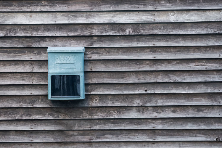 A mailbox on a wall