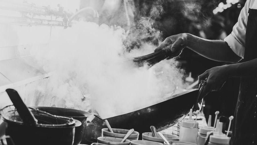 Panoramic shot of man preparing food