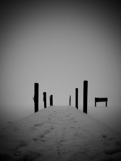 No People Post Nature Sky Vignette Day Outdoors Architecture Land Tranquility Wooden Post Fog Silhouette Wood - Material In A Row Built Structure Tranquil Scene Absence Winter Snow Winter Midnight EyeEmNewHere