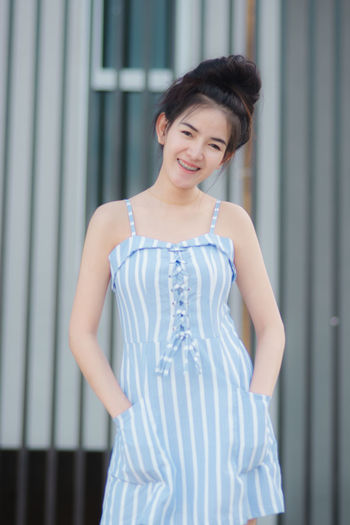 One Person Standing Smiling Three Quarter Length Happiness Young Adult Women Real People Front View Clothing Fashion Beauty Dress Looking At Camera Adult Casual Clothing Portrait Focus On Foreground Hairstyle Teenager Beautiful Woman