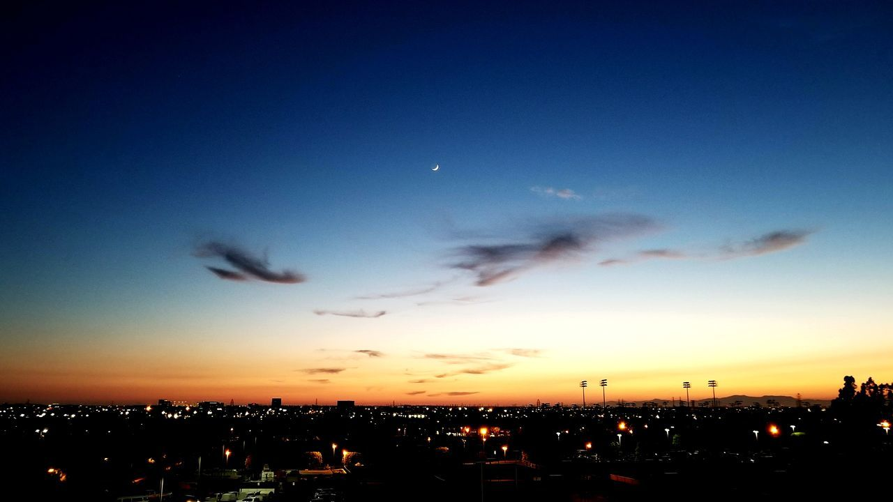 sunset, sky, silhouette, nature, no people, cloud - sky, beauty in nature, dusk, blue, building exterior, scenics, built structure, architecture, outdoors, moon, city, illuminated, night, cityscape