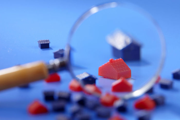 miniature house on the blue background Enlarge Toys Blue Blue Background Buying Close-up Colored Background Focus House Housing Indoors  Investment Magnifying Glass Mini No People Owner Property Real Estate Research Selective Focus Still Life Studio Shot
