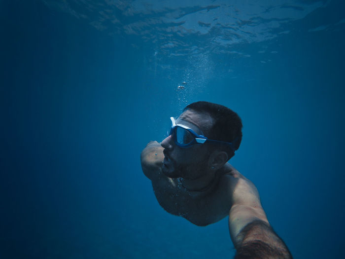 Portrait of man swimming in sea