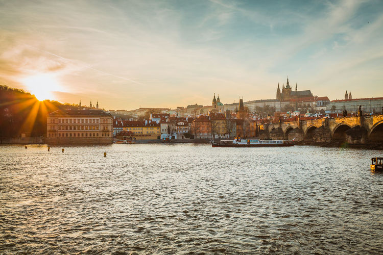 Architecture Building Exterior Built Structure City Cityscape Day Nature Nautical Vessel No People Outdoors Prague River Sky Sunlight Sunset Water Waterfront