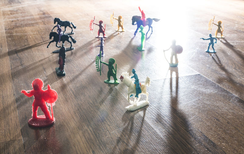 Toys Plastic Vintage People Indian Indians  Cowboy Batle Floor High Angle View Full Length Group Of People Medium Group Of People Group Shadow Crowd Standing Males  Men Day Sunlight Childhood Togetherness Young Adult Indoors  Cooperation
