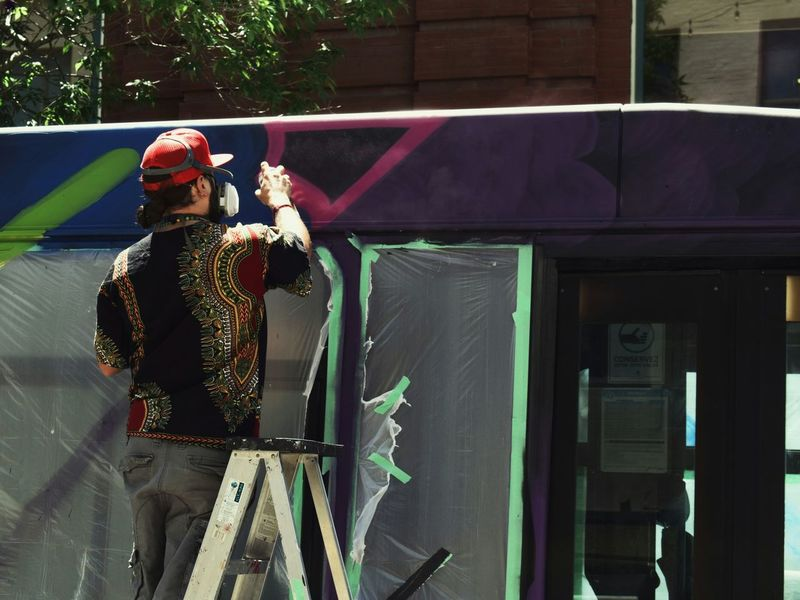 One Person Working Outdoors Standing Graffiti & Streetart Graffiti Art Mural Art Streetphotography The Street Photographer - 2017 EyeEm Awards The Great Outdoors - 2017 EyeEm Awards The Portraitist - 2017 EyeEm Awards The Photojournalist - 2017 EyeEm Awards