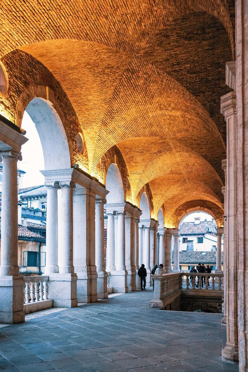 arch, architecture, architectural column, history, corridor, indoors, tourism, travel, built structure, travel destinations, day, no people