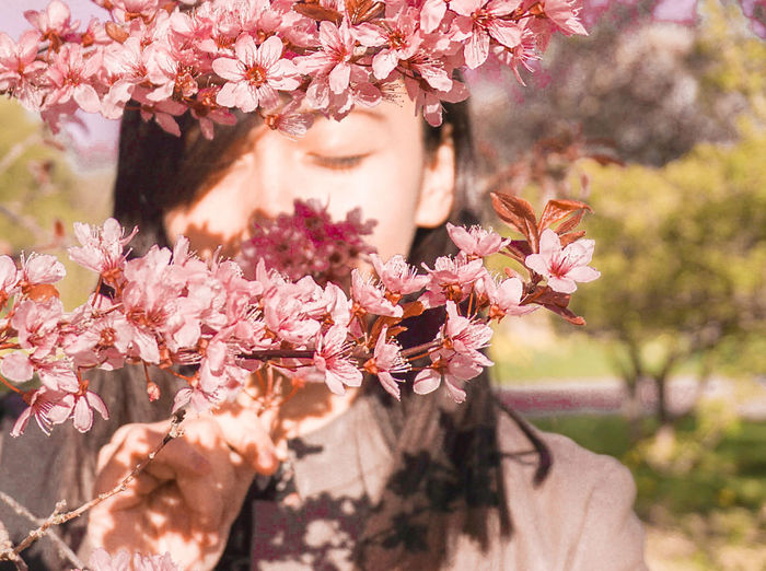 spring Sakura Springtime Spring Sakura Blossom Cherry Blossoms Flowers Tree Flower Blossom Nature Springtime Beauty In Nature Adult Beauty Young Adult Branch One Person Sunlight One Woman Only Human Body Part