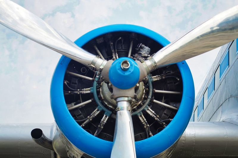 Aerospace Industry Air Vehicle Airplane Blue Close-up Cloud - Sky Day Engine Metal Mode Of Transportation No People Outdoors Plane Propeller Silver Colored Sky Speed Transportation Travel Wheel