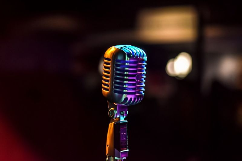 Close-up of microphone in illuminated room