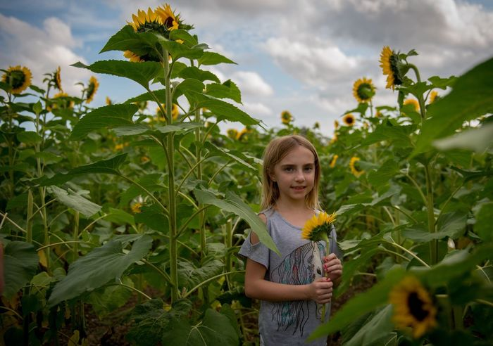 Day Dreaming Portrait Smile Smile ✌ Smiling Plant Leaf Nature Green Focus On Foreground Flowers Cute Outdoors Clouds And Sky Kids Beauty In Nature Beautiful Portrait Of A Woman Portrait Photography Happiness Taking Photos Enjoying Life Yellow Flower Yellow Hello World Kid