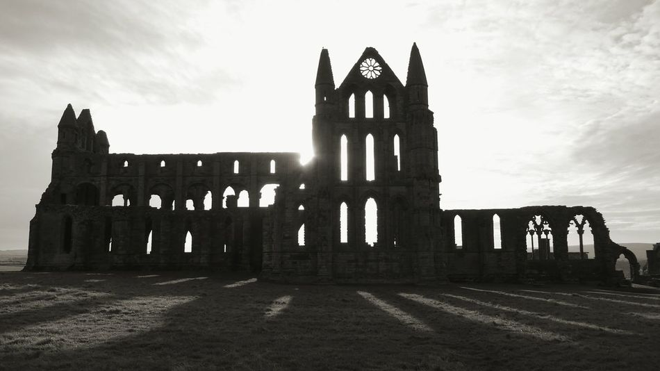 History Spooky Atmosphere Ancient Architecture 657 A.d. Distant Sea Magnificent No People Building Exterior Whitby Abbey Silhouette Sun In Background Architecture Travel Destinations Outdoors Cloud - Sky Grass Built Structure Ruin Building Silhouette Architecture Henry VIII Dissolution Of The Church Cultures Welcome To Black