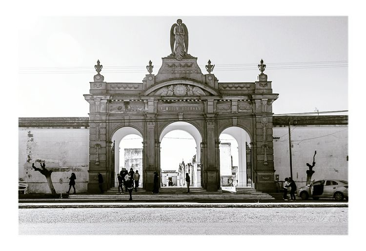 Architecture History Gate Arch Built Structure Façade Ancient City People Outdoors Building Exterior Old-fashioned Day Statue Sculpture Streetphotography Argentina Pehuajo Buenos Aires Cemetery Streetphoto_bw