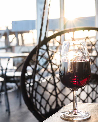 Drink Refreshment Food And Drink Wineglass Glass Sunlight Alcohol Focus On Foreground Red Wine Table Wine Day No People Glass - Material Still Life Nature Close-up Freshness Outdoors Drinking Glass