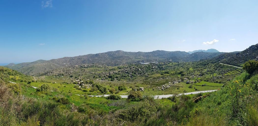 Panoramic view of village with rocky mountains in backround Trees Countryside Scenery Boulders Greek Islands Rock - Object Grassy Grass Village Houses Outdoors No People Bushes Flowers Plants Village Mountain Agriculture Sky Geology Cultivated Land Countryside Tranquil Scene Scenics