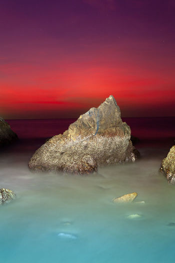 waves hit the big cone shape rock in the middle of stone cape during sunset at banana beach Phuket Cone Cone Shaped Stone, Rocky Mountains Stone Cape, Dracula, Venice Red,sky, Island, Wave, Sea, Edit, Travel, Sunset, Middlw, Banana Beach, Water Scenics - Nature Sea Sky Tranquility Beauty In Nature Nature Tranquil Scene Waterfront Rock Solid Rock - Object No People Idyllic Reflection Sunset Horizon Over Water Outdoors