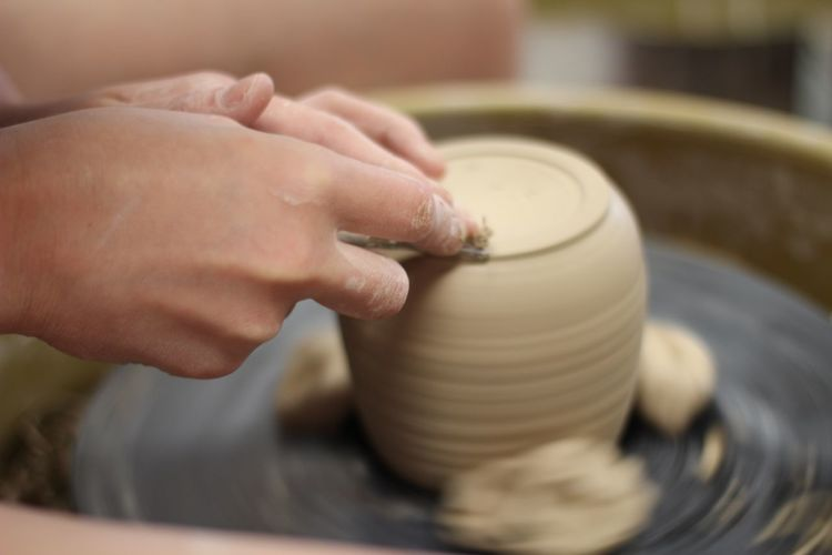 Cropped Hands Making Pottery