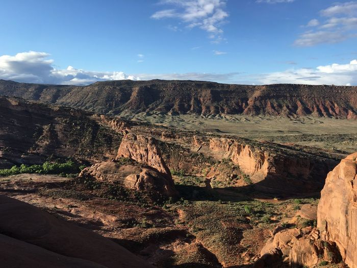 Scenic view of rocky mountains against sky at arches national park
