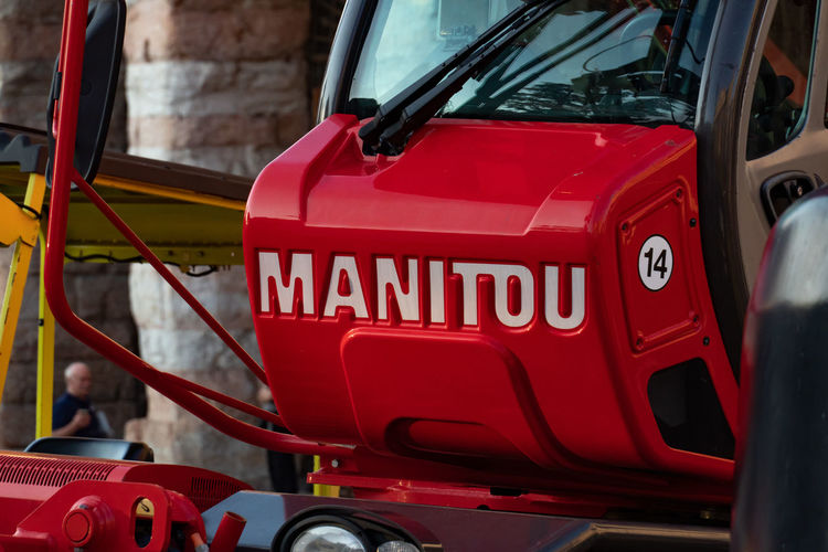 Manitou forklift truck. Manitou UK is a firm which makes fork lifts and other powered materials lifting devices, and cherry pickers Forklift Forklift Trucks Industrial Close-up Equipment Fork Truck Forklift Truck Forklifts Jitney Land Vehicle Manitou Mode Of Transportation Motor Vehicle No People Red Sign Transportation