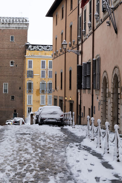 Rome, Italy - February 26, 2018: An exceptional weather event causes a cold and cold air across Europe, including Italy. Snow comes in the capital, covering streets and monuments of a white white coat. In the photo Via Nazionale. Ice Architecture Building Exterior Built Structure Car City Climatic Event Cold Temperature Day Green Light Land Vehicle Mode Of Transport Nature No People Outdoors Residential Building Sky Snow Stationary Street Transportation Weather Winter