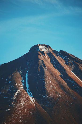 Scenic view of mountain against blue sky at atacama desert