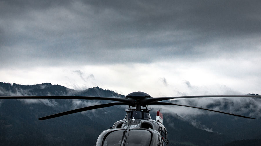 Close-up of helicopter against sky