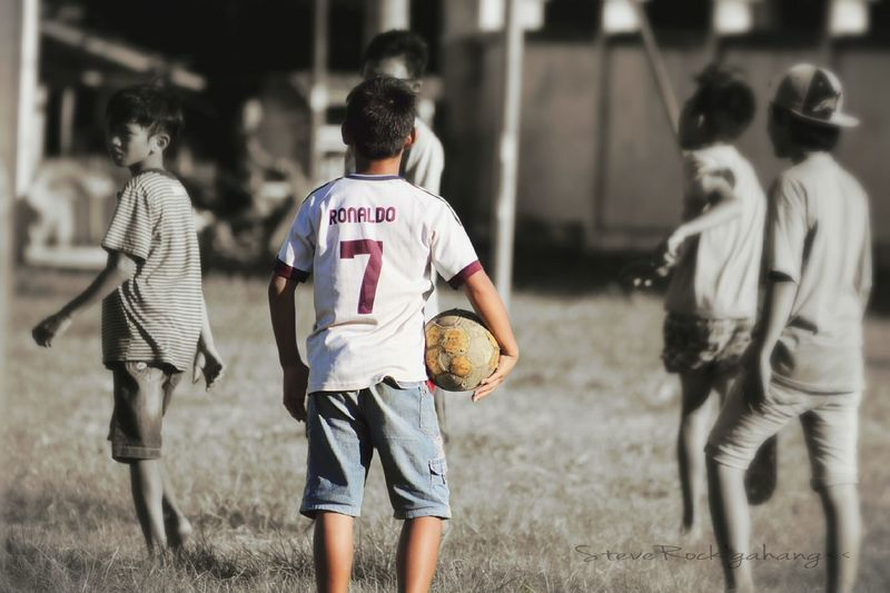 The Color Of Sport Standing Friendship Boys Lifestyles Childhood Bonding Togetherness Lifestyles Childhood Boys Walking Standing Person Focus On Foreground Field Friendship Person Day First Eyeem Photo